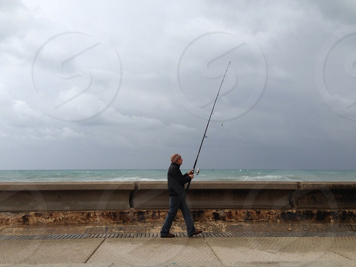 man holding with the fishing rod  photo