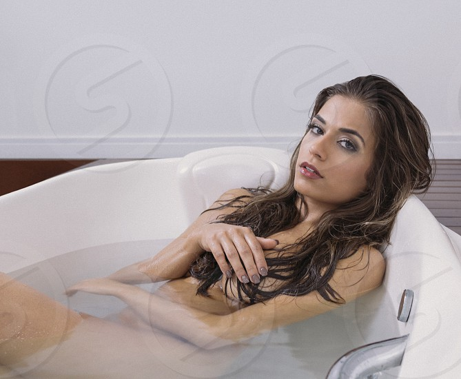 naked woman in white bath tub photo