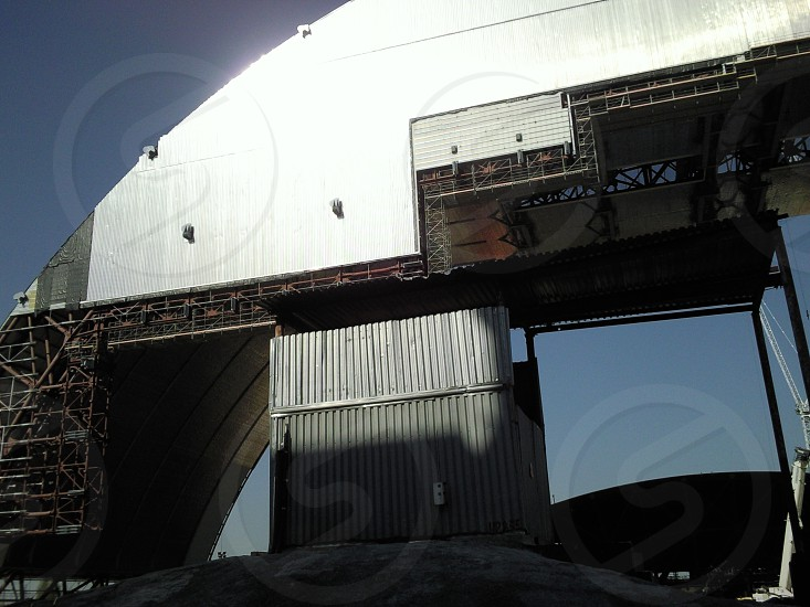 The Unfinished New Safe Confinement of the Chernoby Nuclear Power Station viewed from inside the Restricted Access Zone. photo