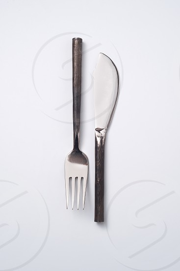 Composition from vintage metal fork and knife on a gray background with space for text. Flat lay photo