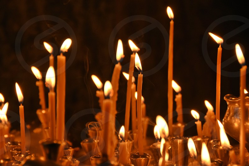 lighted candle closeup photography photo