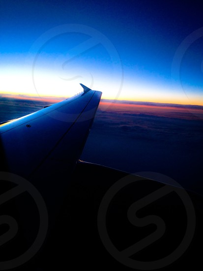 airplane wing and sunset photo