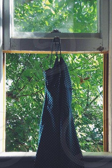 hanged black apron with white dots photo