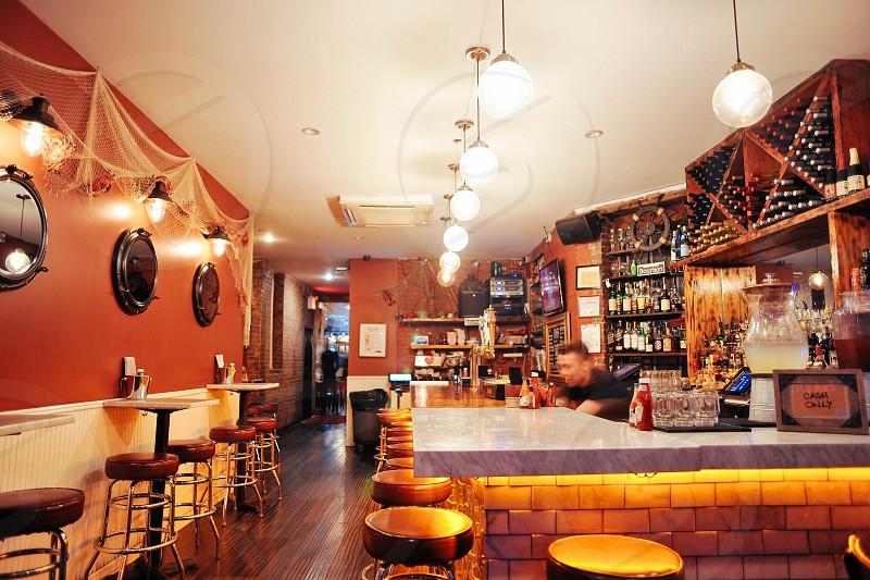 white pendant lamps over brown bar stool in building photo