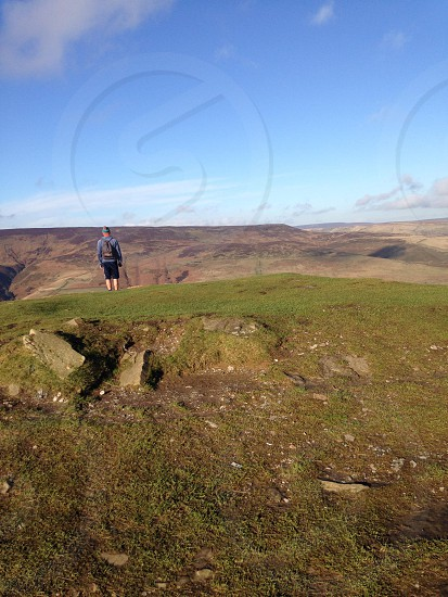 rambler at the peak of lose hill in the peak district derbyshire photo