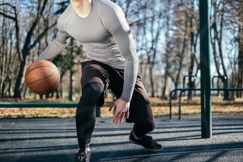 the man plays basketball photo