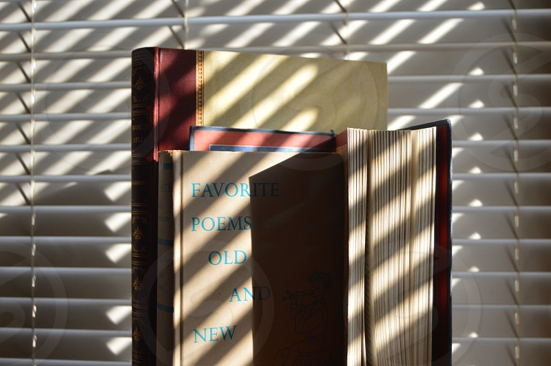 light rays sun blinds books old books antiques  photo