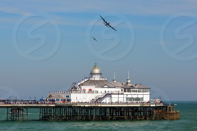 Avro Lancaster and Spitfire MK1 Flying over Eastbourne Pier photo