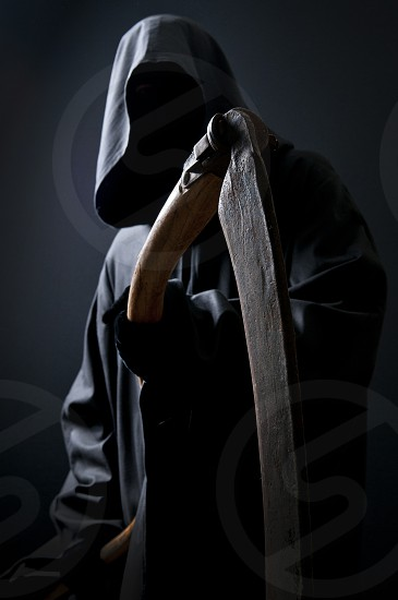 Grim reaper with a sickle. photo