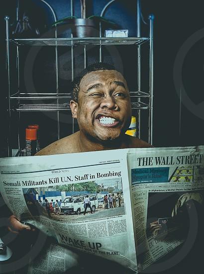 man reading wall street journal newspaper photo