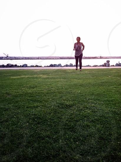 woman in gray shirt jog photo