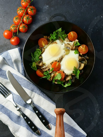 fried eggs with vegetables tomato food eat overhead photo