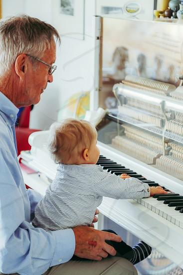 Creatives music piano playing child adult indoors instrument  music instrument  musician kid photo