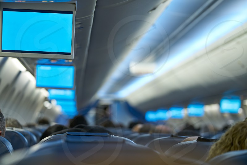 Aircraft indoor tv screens in a row selective focus photo