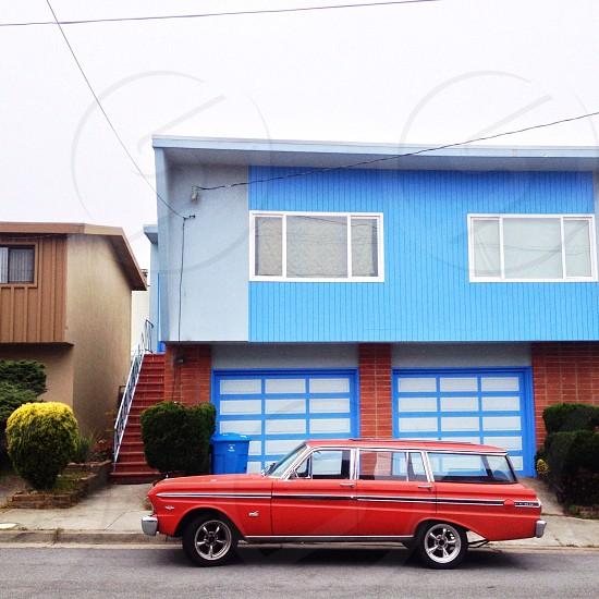 red 4 door station wagon photo