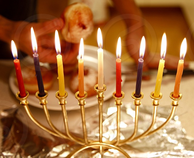 Celebrating Hanukkah a jewish holiday were we light a candle every night for 8 days. Also it is a tradition to eat donuts (sufganiyah). photo