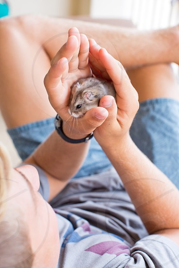 Teen boy with his miniature Hampster photo