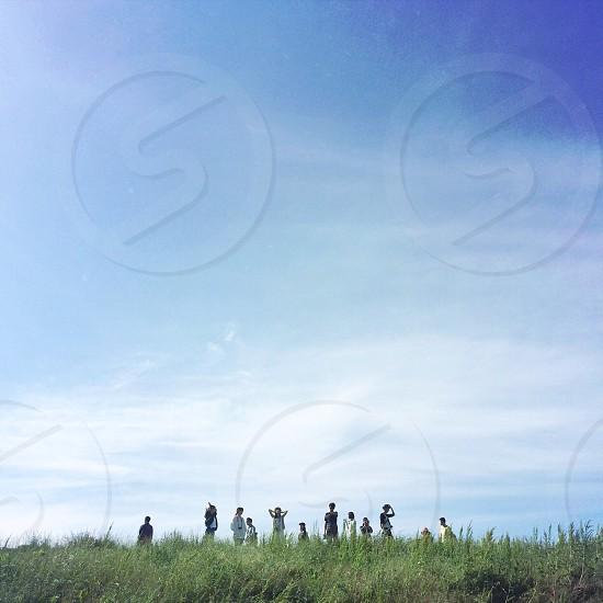 people on green field photo
