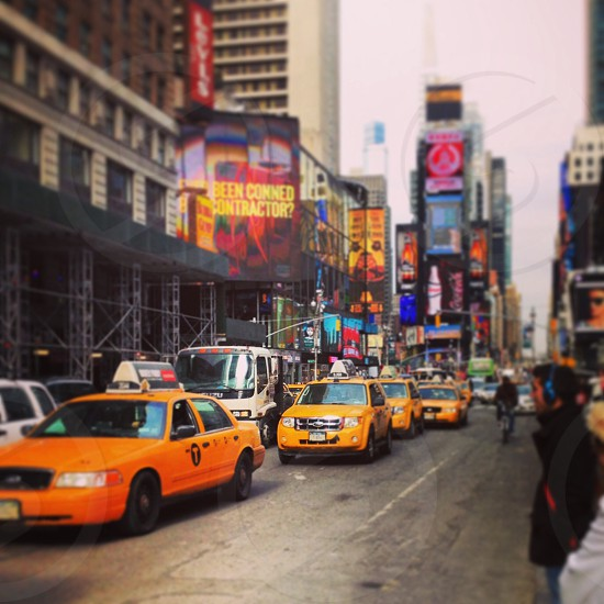 yellow taxi cabs in the street photo