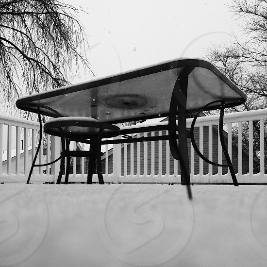 snow covered outdoor black table photo