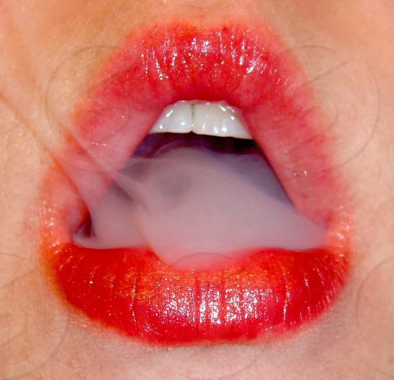 Blowing smoke photo