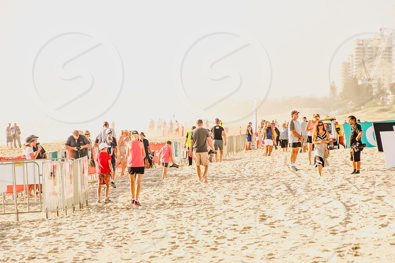 people gathering at the beach for an event on a foggy morning  photo