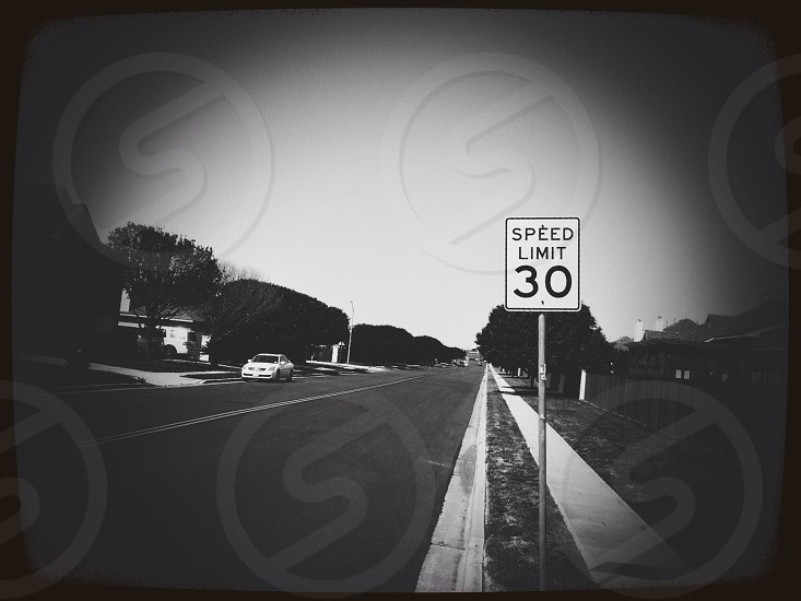 A black and white of a street located in Round Rock Texas.  photo