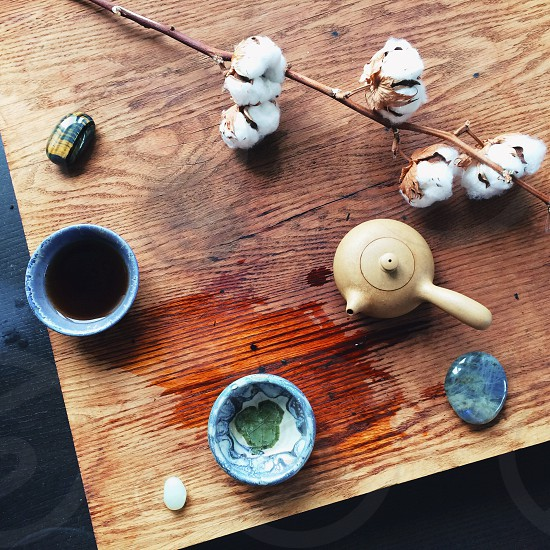 Nicely decorated tea set on a wooden desk table. photo