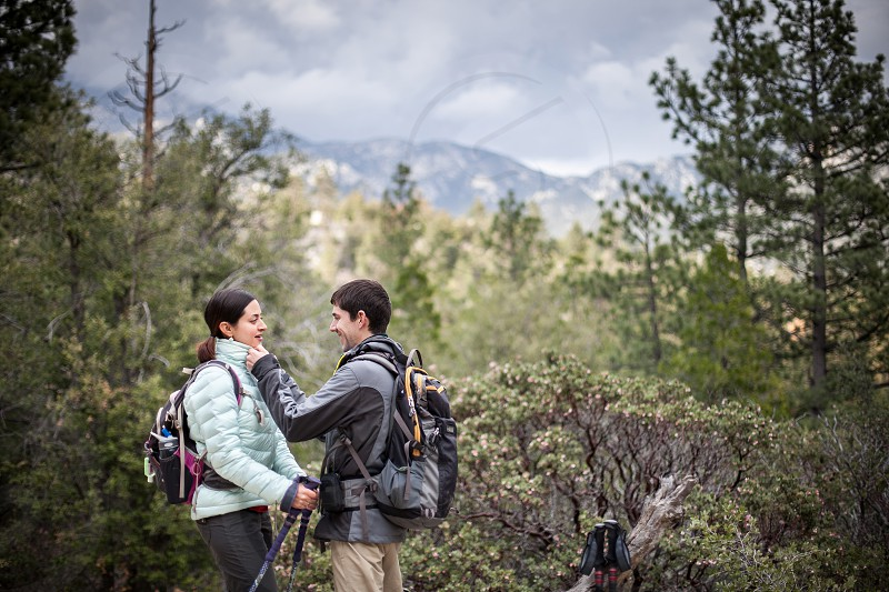 A couple prepares for a hike in the mountains. photo