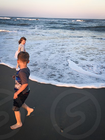 My little kids at the beach traveling to va photo