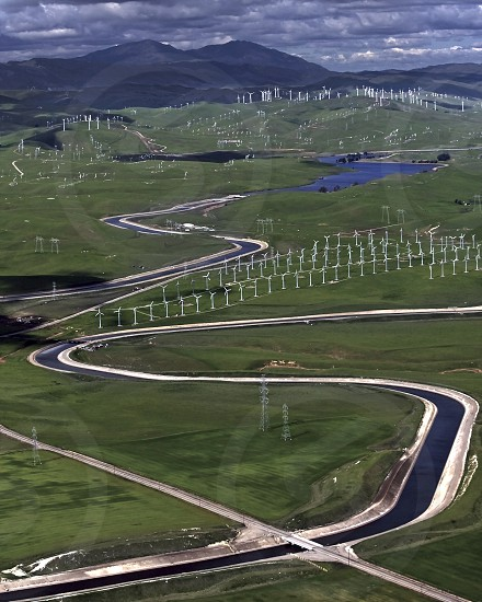 Under the shadow of Mount Diablo Bethany Reservoir is the inception point of the California Aqueduct as windmills divide it from the Delta-Mendota Canal as water is transferred from the California Delta the west's largest estuary that provides water for 23 million Californians. photo
