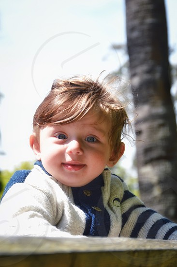 Baby Child Smiling Cheerful Human Face Happiness Cute Toddler Healthy Lifestyle Laughing Portrait Human Hand People Childhood Close-up Beautiful Beauty warm  Baby Boys Care Fun Joy Lifestyles New Life Small Blue Eyes Life White Background Facial Expression Clean Male Human Thumb Human Finger Innocence Expressing Positivity Vertical Color Image One Little Boy 0-6 Months Full Frame happy  photo