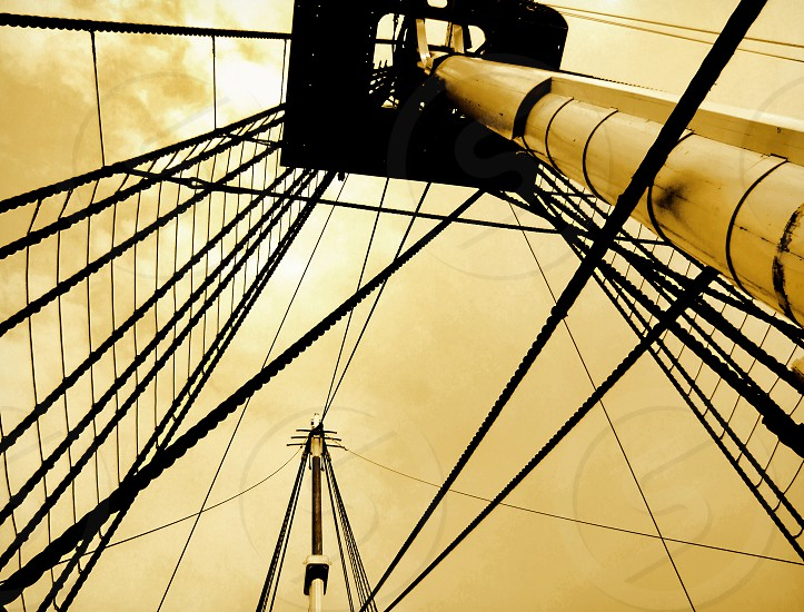 Looking up and through ropes and ladders  to a platform on a ship's mast. photo