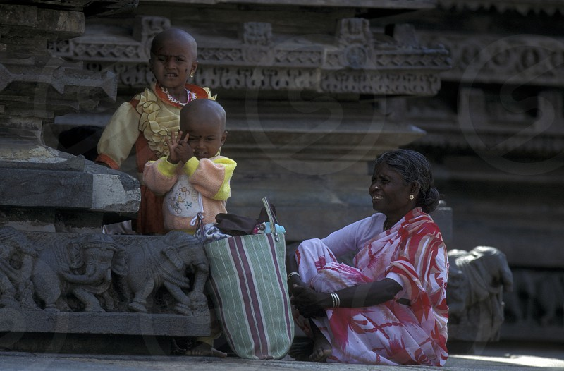 a family at the Temple of the Village of Hampi in the province of Karnataka in India. photo