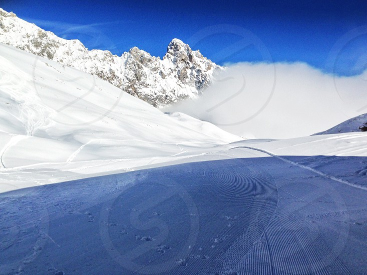 snow cover mountain during daytime photo