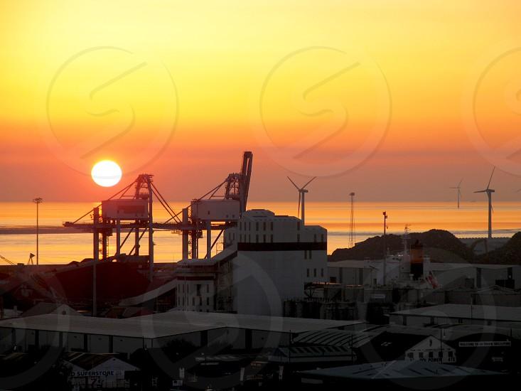 Industrial grain silos at sunset photo