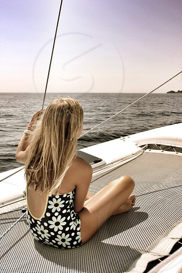 Young Girl on Sailboat Buzzards Bay Cape Cod MA photo