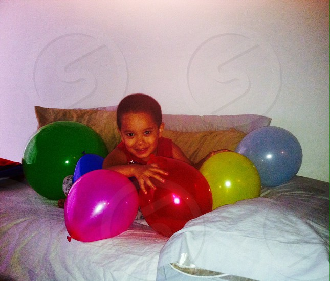 Baby loves his balloons in the morning bright and early I many different colors and sizes!!! photo