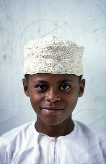 a boy in the city of Moutsamudu on the Island of Anjouan on the Comoros Ilands in the Indian Ocean in Africa.    photo