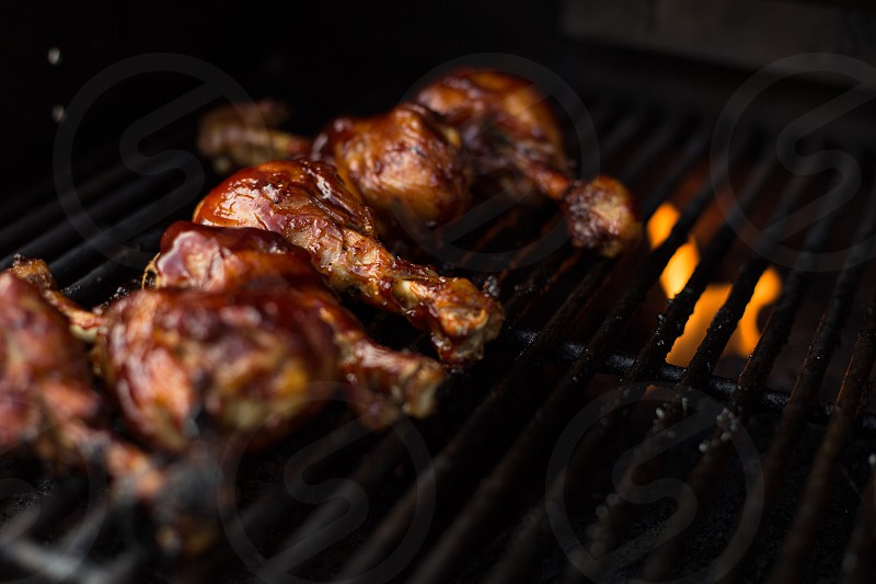 BBQ Chicken Cooking on the Grill photo