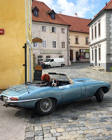 Cesky Krumlov Czech Republic classic car convertible medieval town vehicle transportation  photo
