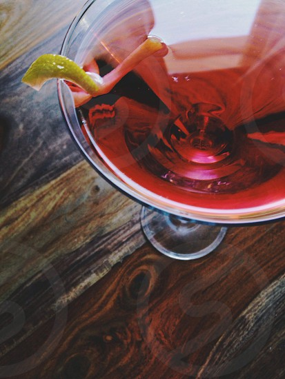 red martini with lime zest photo