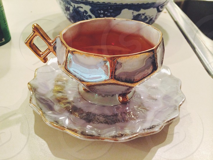 gray and gold cup and saucer photo