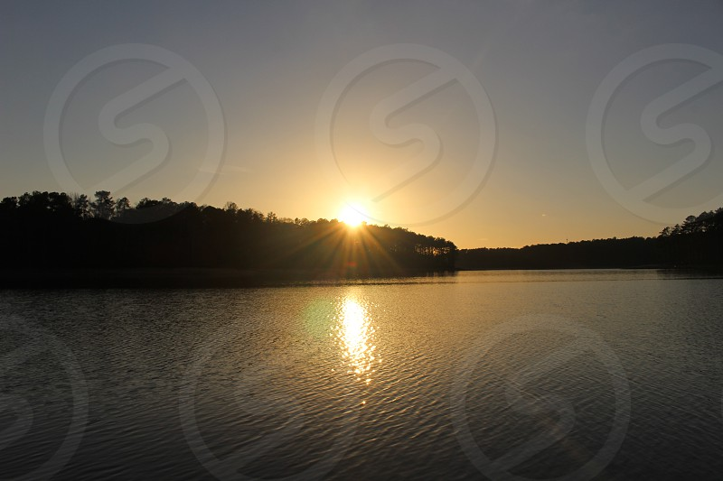 sunset over lake in winder georgia photo