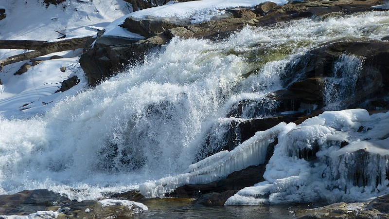 Water fall on frozen river photo