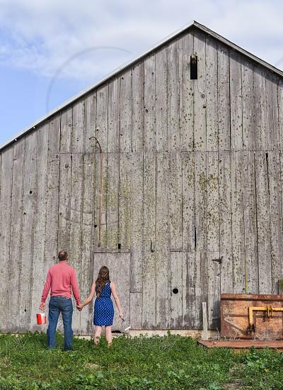 barn paint home improvement couple wood work photo