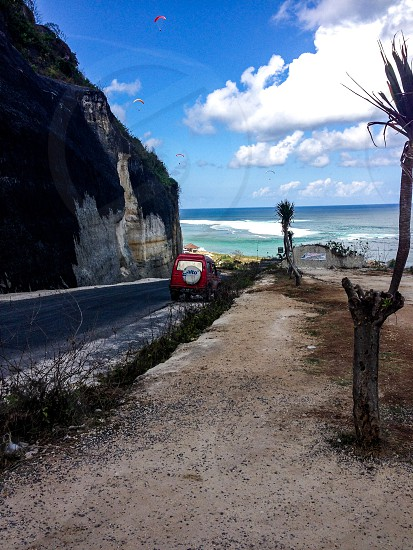 Bali beaches road to the seaside parasailing activities lifestyle photo