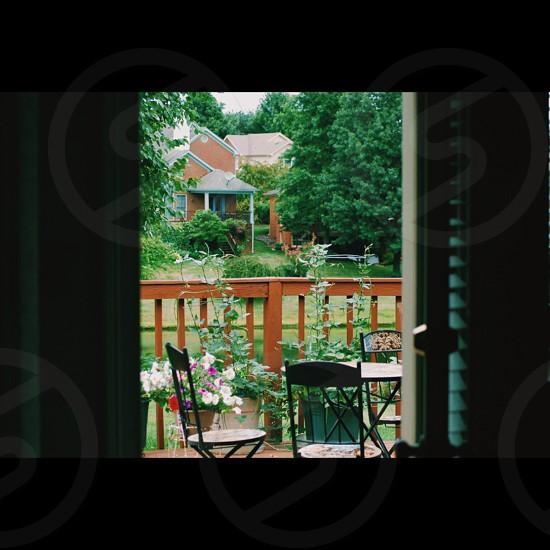 three wooden chair beside railings photo