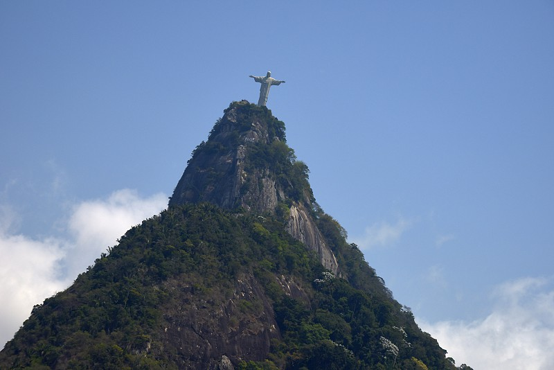 Mountain with the Christ the Redeemer statue on top of it in Rio de Janeiro Brazil photo