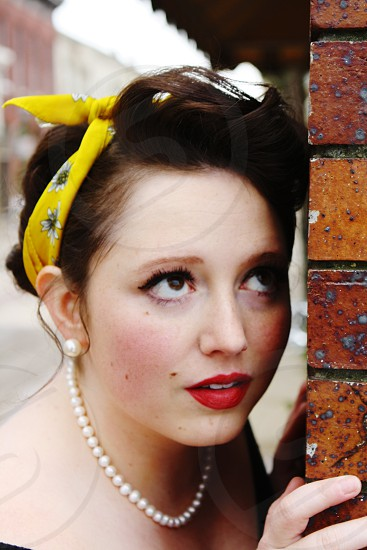Michelle is a modeling for a 50's-60's themed photo shoot very glam with the bandana and red lips photo